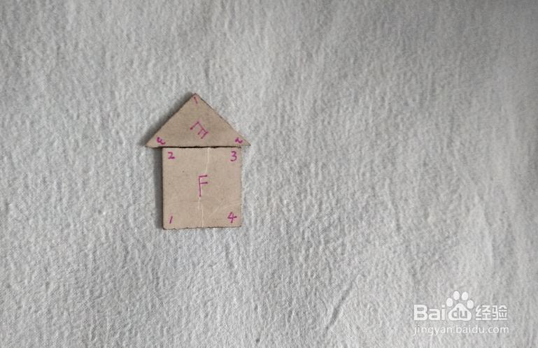 用七巧板怎样拼一座建在小岛上的房子?